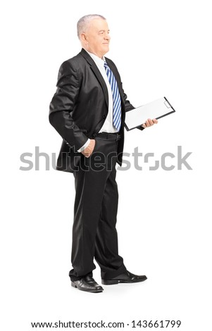 Full length portrait of a mature businessman posing with clipboard isolated on white background - stock photo