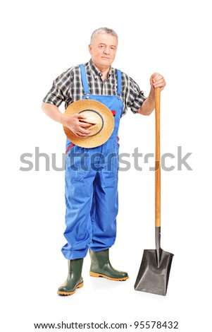 Full length portrait of a mature farmer holding a shovel isolated on white background - stock photo