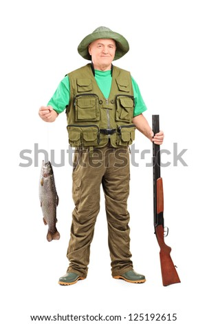 Full length portrait of a mature hunter with shotgun holding a fish isolated on white background
