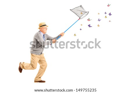 Full length portrait of a mature man running and catching butterflies with net isolated on white background - stock photo