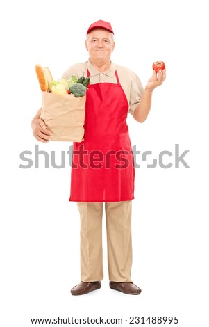 Full length portrait of a mature market vendor holding a grocery bag isolated on white background - stock photo