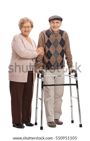 Full length portrait of a mature woman and a mature man with a walker isolated on white background