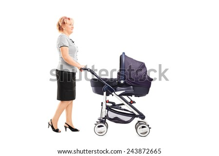 Full length portrait of a mature woman pushing a baby stroller isolated on white background - stock photo