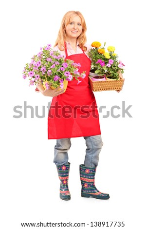 Full length portrait of a middle aged female florist holding flowers isolated on white background - stock photo