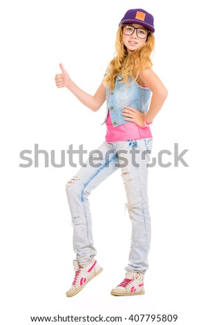 Full length portrait of a modern teenager girl.  Studio shot. Isolated over white. Copy space.