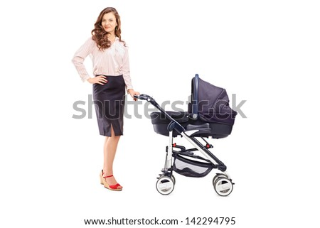 Full length portrait of a mother with a stroller, isolated on white background - stock photo