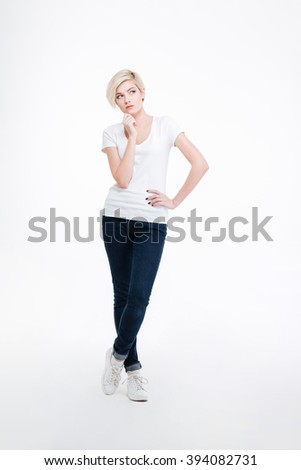 Full length portrait of a pensive woman standing isolated on a white background - stock photo