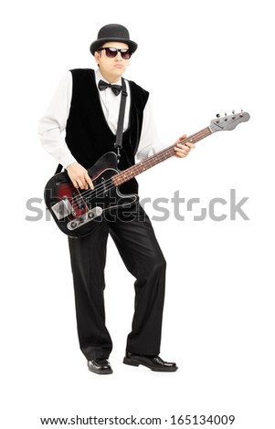Full length portrait of a person playing a bass guitar isolated on white background - stock photo