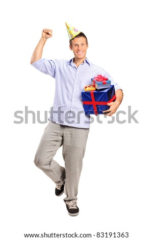 Full length portrait of a person wearing a party hat and holding a gift isolated on white background - stock photo