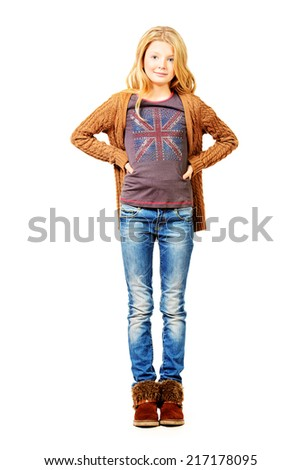 Full length portrait of a pretty ten years girl. Isolated over white. - stock photo