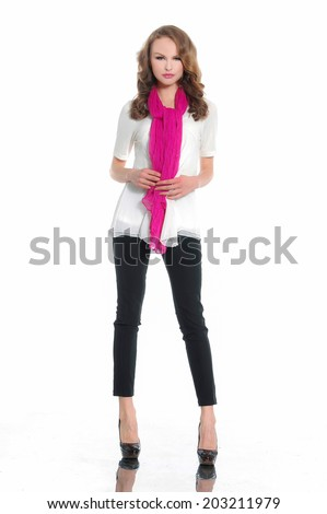 Full length portrait of a pretty young woman in red scarf posing - stock photo