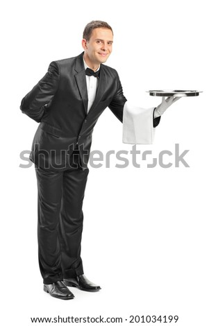 Full length portrait of a professional waiter holding a tray isolated on white background - stock photo