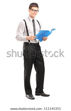 Full length portrait of a professional young man holding a fascicule isolated on white background - stock photo