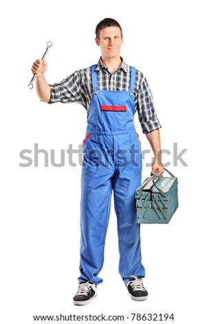 Full length portrait of a repairman in overall holding a wrench and toolbox isolated on white background - stock photo