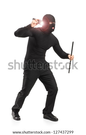 Full length portrait of a robber with robbery mask holding a flashlight and piece of pipe isolated on white background - stock photo