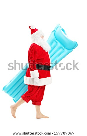 Full length portrait of a Santa claus walking with a swimming mattress isolated on white background - stock photo
