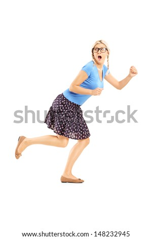 Full length portrait of a scared woman running away isolated on white background - stock photo