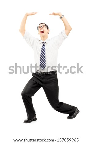 Full length portrait of a scared young man protecting from above with his hands isolated on white background - stock photo