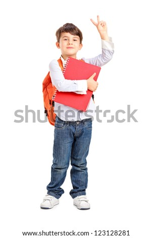 Full length portrait of a school boy holding a notebook and gesturing isolated on white background - stock photo
