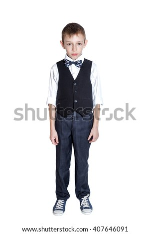 Full length portrait of a school boy isolated white background - stock photo