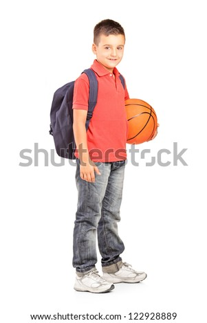 Full length portrait of a school boy with backpack holding a  basketball isolated on white background - stock photo