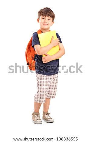 Full length portrait of a school boy with backpack holding a notebook isolated on white background - stock photo