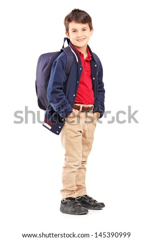 Full length portrait of a school boy with backpack standing and looking at camera, isolated on white background - stock photo