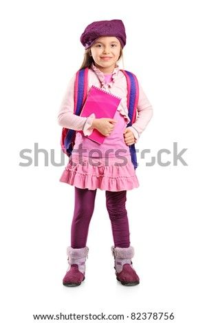 Full length portrait of a school girl with backpack holding a notebook isolated on white background