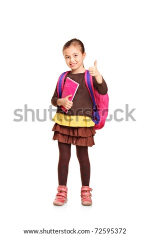 Full length portrait of a school girl with backpack holding book and showing thumb up isolated on white background
