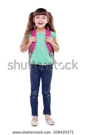 Full length portrait of a schoolgirl standing on white background - stock photo