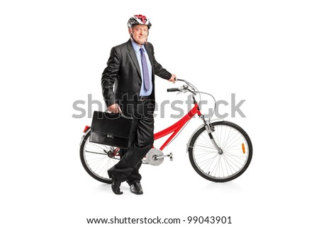 Full length portrait of a senior businessman posing next to a bicycle isolated on white background - stock photo