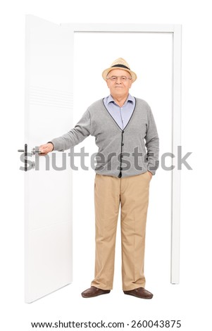 Full length portrait of a senior entering a room isolated on white background - stock photo