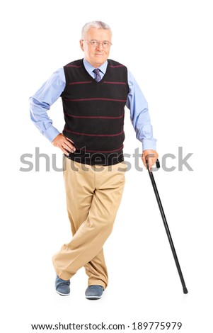 Full length portrait of a senior gentleman with cane posing isolated on white background