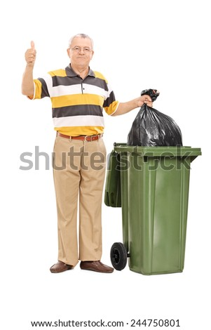 Full length portrait of a senior giving a thumb up by a trash can isolated on white background - stock photo