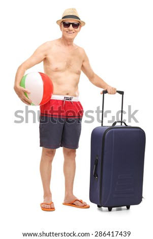 Full length portrait of a senior in swim shorts holding a beach ball and a bag isolated on white background - stock photo