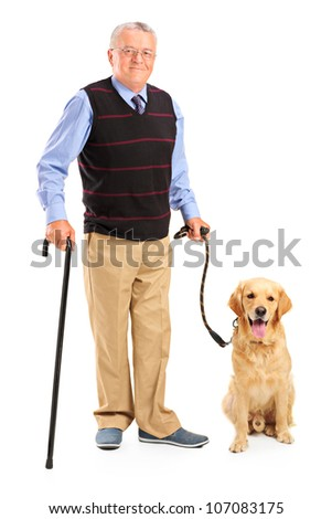 Full length portrait of a senior man holding a cane and a dog isolated on white background - stock photo