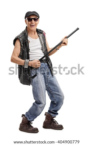 Full length portrait of a senior punk rocker pretending to play guitar on his cane isolated on white background - stock photo