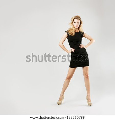 Full Length Portrait of a Sexy Blonde Woman in Little Black Fashion Dress - stock photo