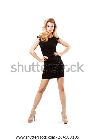Full Length Portrait of a Sexy Blonde Woman in Little Black Fashion Dress. Isolated on White. Fashion and Beauty Concept. - stock photo