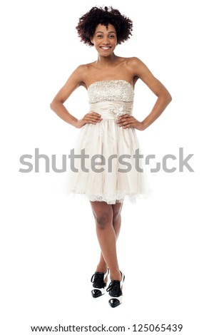 Full length portrait of a sexy woman in corset dress doing catwalk. Isolated over white.
