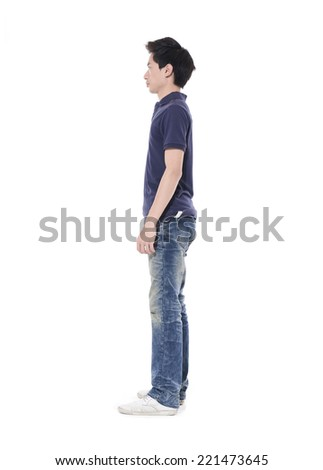 Full length portrait of a side view young casual young man - stock photo