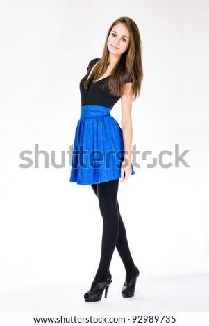 Full length portrait of a slender brunette young model. - stock photo