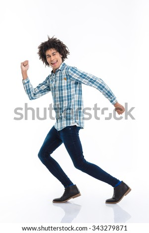Full length portrait of a smiling afro american man running isolated on a white background - stock photo