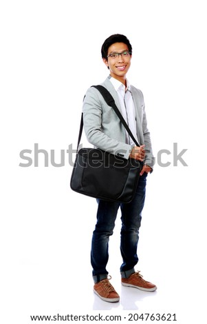 Full length portrait of a smiling asian man standing with briefcase over white background - stock photo