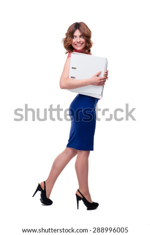 Full length portrait of a smiling businesswoman holding folders isolated on a white background. Looking away - stock photo