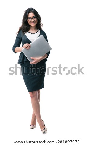Full length portrait of a smiling businesswoman in glasses holding laptop isolated on a white background. Looking at camera