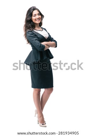 Full length portrait of a smiling businesswoman standing with arms folded and looking away - stock photo