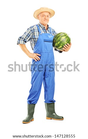 Full length portrait of a smiling farmer holding a watermelon isolated on white background - stock photo