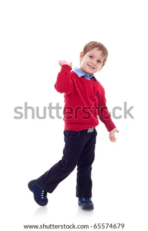 Full length portrait of a smiling little boy in jeans on white background - stock photo