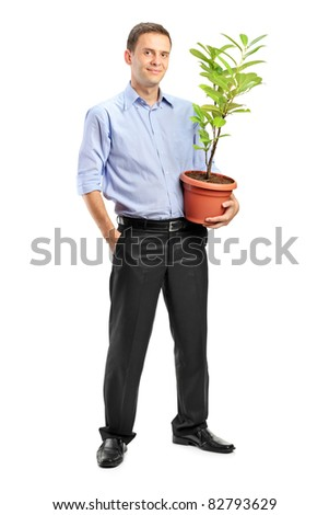 Full length portrait of a smiling man holding a pot with decoration plant isolated on white background - stock photo